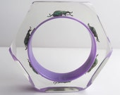 Gorgeous purple lucite bangle with real beetles