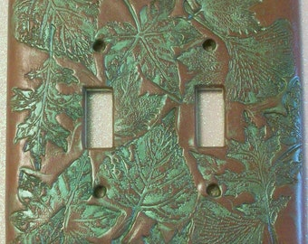 Double toggle light switch cover Collage of leaves in nutmeg brown and metallic green
