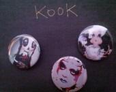 a variety kook teflon buttons dolls paintings portraits
