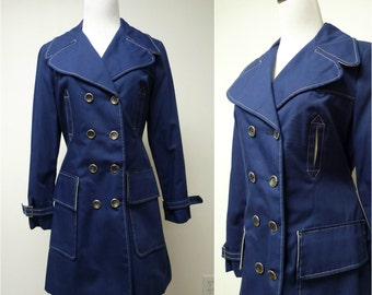 More Than O-KAY FASHIONS . navy blue trench coat . fits a small to medium