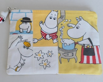 Pretty zippered blue yellow white red pouch and a charm with Moomins