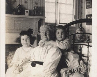Vintage photo Grandmother Loved Hugged by Children on Bed