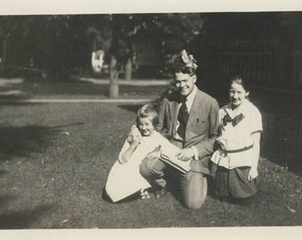 Vintage photo 1917 Father 2 Daughters He Wears the Hair Bow Good Sport