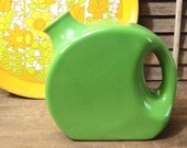 Nice green ceramic disk pitcherc from the 40's 50's  dis