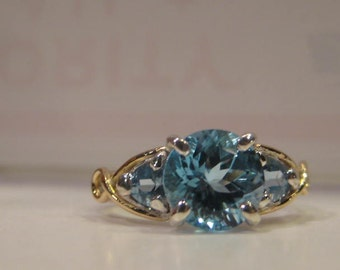 Faceted Blue Topaz Ring ... Sterling Silver and 14 kt Gold Ring ... Size 6 1/2    ................. e881