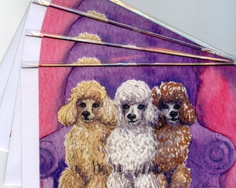 4 x poodle dog greeting cards - three's a pack apricot poodle white poodle cream poodle chocolate poodle sitting on an armchair three dogs