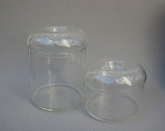 Vintage Glass Canisters Stylish Storage Indented Lids Two Sizes Sleek Modern Design