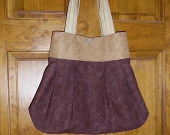 Brown and tan hobo bag