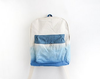 Blue dyed backpack with azure blue pouch