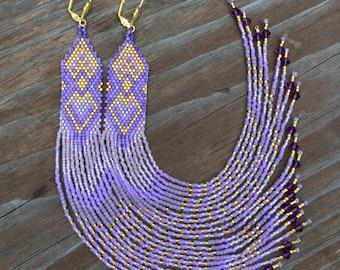 Purple shoulder duster earrings