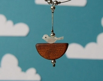 50 % off Nesting necklace - wood and vintage mother of pearl bird