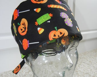 Tie Back Surgical Scrub Hat with Tossed Halloween Candy Pumpkins