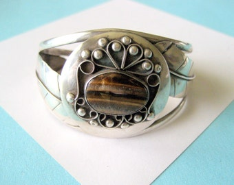 Navajo Sterling Silver and Tigers Eye Feather Cuff