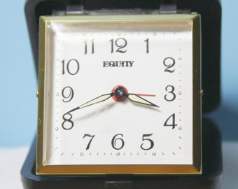 Vintage Equity Travel Alarm Clock in a Leather Fold out Case.