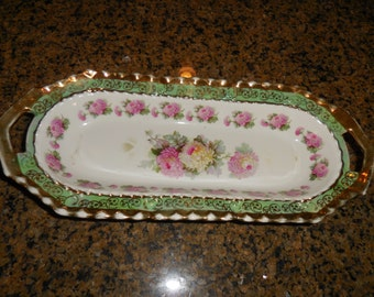 A Beautiful Oval Bowl With Roses