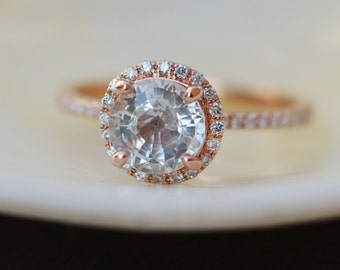 Rose gold diamond ring engagement ring with 1.53ct round white sapphire. Diamond halo rings