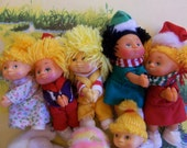 lot of clip on cabbage patch mini dolls