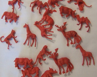 wee tiny red plastic animals