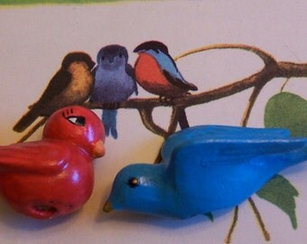 two cute tiny ceramic birds