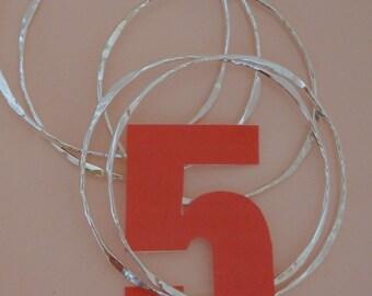 Set of Five Hammered Silver Bangles