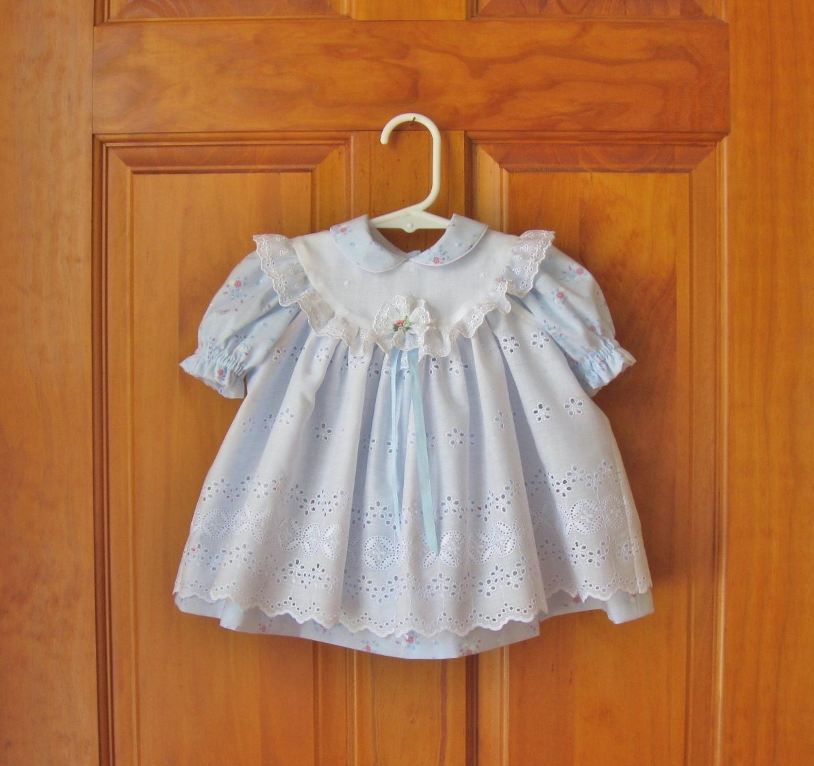 Baby girl blue dress white eyelet pinafore by