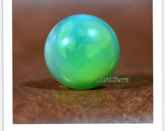 Rare opportunity to Purchase Tanzanian Chromium Green Opal 18mm Rd X 8mm h.