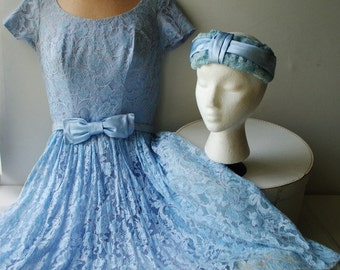 Wedding vintage 50s pastel blue lace , hnad made dress with pastel lavander lining, belt-bow and matching headband. Size Small.