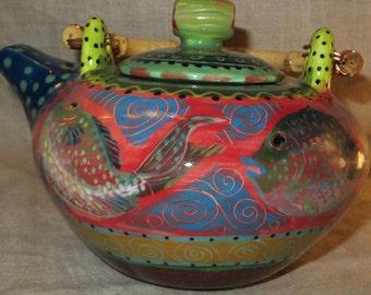 Vivid colors on Asian style fish teapot
