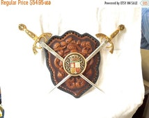 SUMMER SALE Crossed Swords WALL Shield leather tooled crest   miniatute spanish style panoplay wall plaque with damascene detail