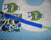 Dylan Personalized Burp Bib and a Universal Pacifier Clip -  made with  Blue 2D Zoo Fabric - Name and/or upto 3 initials