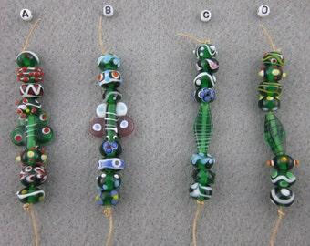 Emerald green lampwork beads, rondelle shape, 12mm diameter, 4 colorways, 8 beads per colorway, LOWER PRICE!