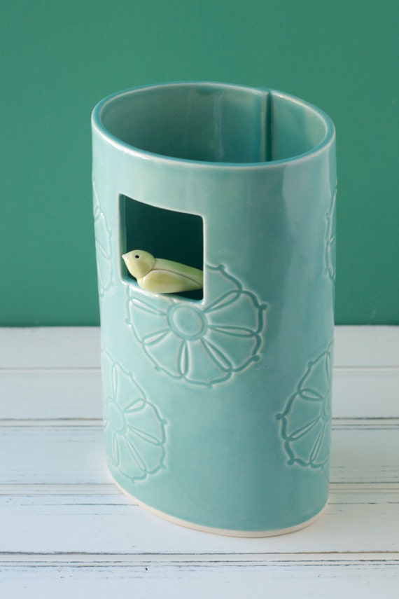 Blue window vase with little perched bird