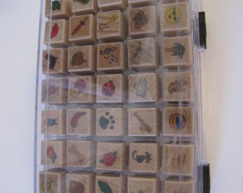 Stamps box of 40 3/4 inch variety of designs  most not used
