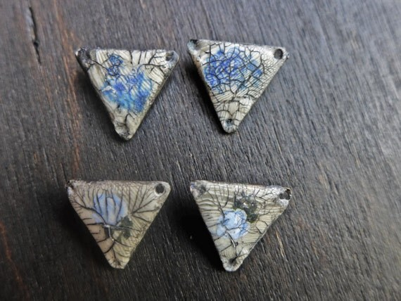 Rustic polymer clay triangle earring pairs with blue rose decals and crackle. Handmade artisan art beads