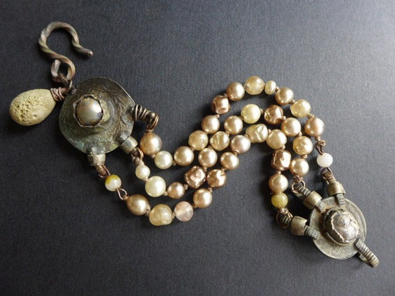 Isangelous. Rustic assemblage bracelet with antique Kuchi and baroque glass pearls.