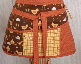 Vendor apron with zippered pocket Pumpkin orange and brown with birds