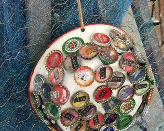 Refrigerator bottle cap magnets.  A little something for everybody!