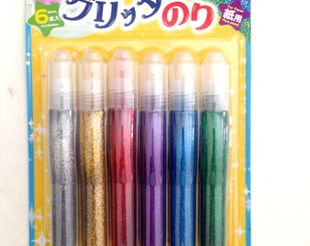 Glittery Glue, colorful, gold, silver, green, red, purple, blue, green, craft, paper, card, crafting, children, kid, school, glue pen