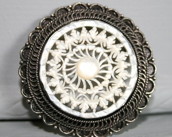 950 Bethlehem Carved Mother of Pearl Brooch