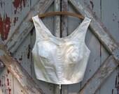 Bullet girl - vintage white bullet bra