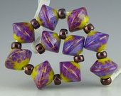 a set of 10 mini bicone beads in green ochre with brilliant purple frit handmade lampwork glass - Purple Rose