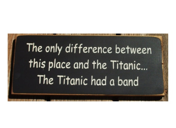The only difference between this place and the Titanic... primitive wood sign