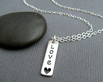 tiny love word necklace. small sterling silver rectangle charm. heart cut out. romantic. vertical tag small simple jewelry. everyday pendant