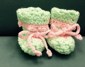 Green and pink crocheted booties