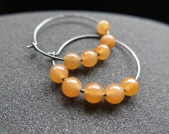 peach aventurine earrings. orange stone hoops. hypoallergenic ear wires in niobium wire.