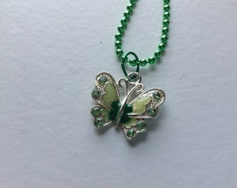 Green butterfly pendant