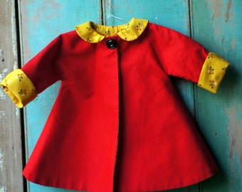 Dolls swing coat in ruby red with yellow floral lining for 16 and 18 ins dolls