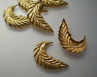 6 brass leaf charms, No. 7