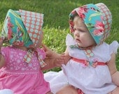 BLISSFUL BOUQUET, a reversible flip-me-back sun bonnet, in lush corals and aqua, matches Bliss Tula, bonnet from Bella Sol Bebe