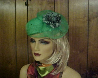 "Green pill box hat with large stiff ribbon side bow and fabric flower- fits- 23""- chin strap"